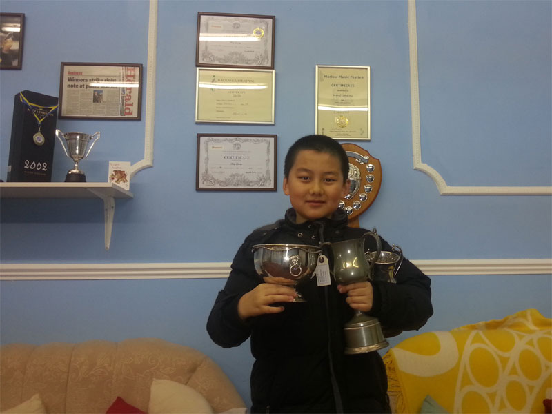 Young Student With Trophies