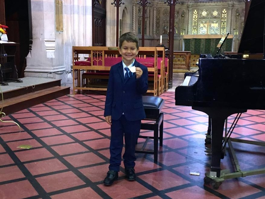 Daniel With His Gold Medal From Windsor Piano Festival 2015